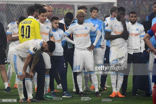 Marseille's Cameroonian forward Clinton Njie and teammates react after being defeated by Atletico after the UEFA Europa League final football match...