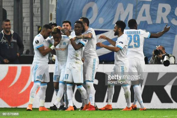 TOPSHOT Marseille's Cameroonian forward Clinton Njie celebrates with team mates after scoring a goal during the UEFA Europa League firstleg semifinal...