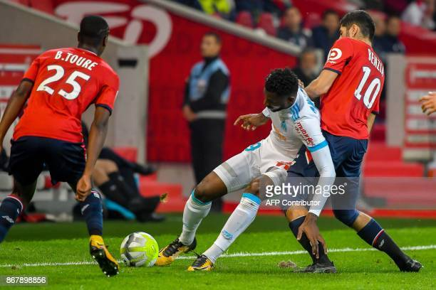 Marseille's Cameroonian midfielder Andre Zambo Anguissa vies with Lille's French forward Yassine Benzia during the French L1 football match between...