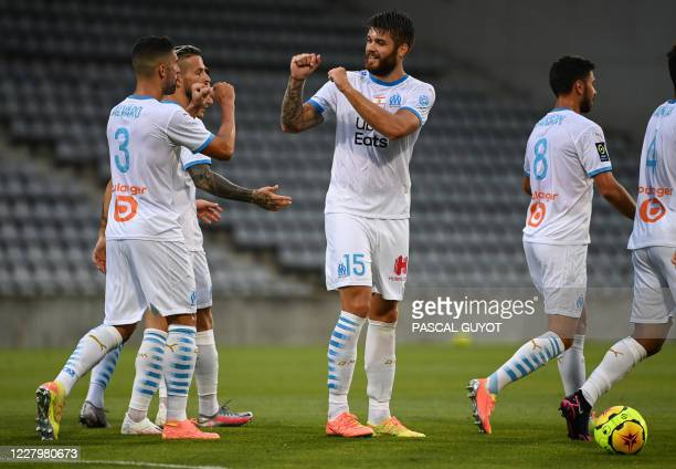 Marseille's Croatian defender Duje Caleta Car reacts after scoring a goal during the French friendly football match between Nimes Olympique and...