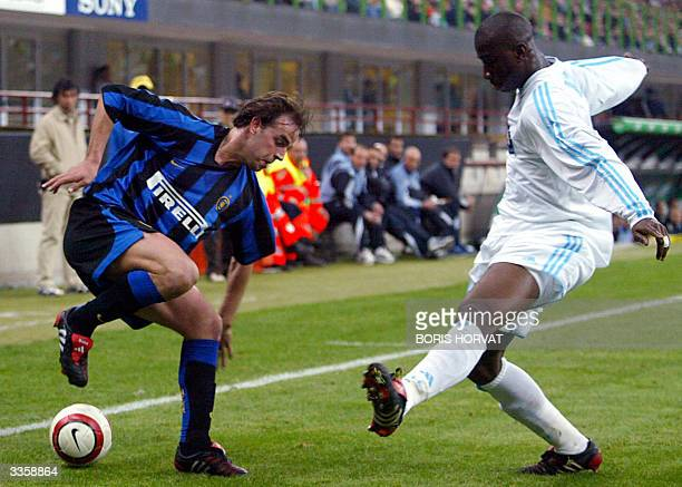 Marseille's defender Abdoulaye Meite fights for the ball with Inter Milan's forward Andy Van Der Meyde during their quarterfinal UEFA cup match 14...