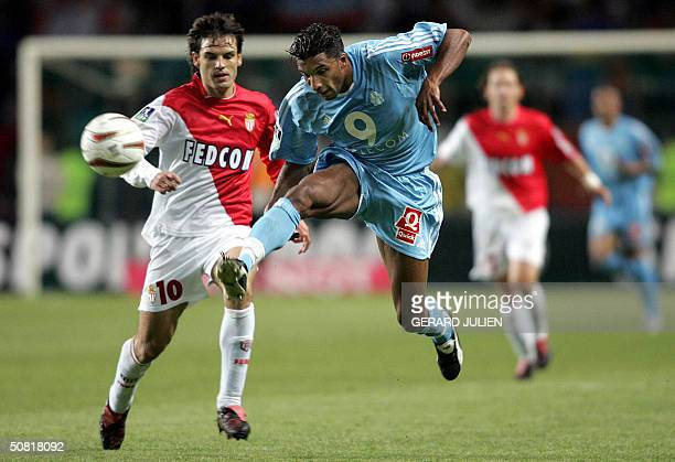 Marseille's defender Habib Beye is challenged by Monaco's forward Fernando Morientes during their French L1 football match 09 May 2004 at the Louis...
