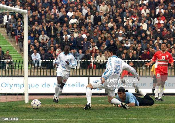 OM Marseille's Edouardo Tuzzio and Ibrahim Bakayoko get past the Algerian national team goalie during their friendly match in Algiers 28 February...