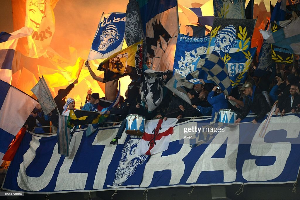 Marseille's fans cheer during the French L1 football match Olympique Lyonnais (OL) vs Olympique de Marseille (OM) on March 10, 2013 at the Gerland stadium in Lyon, southeastern France.