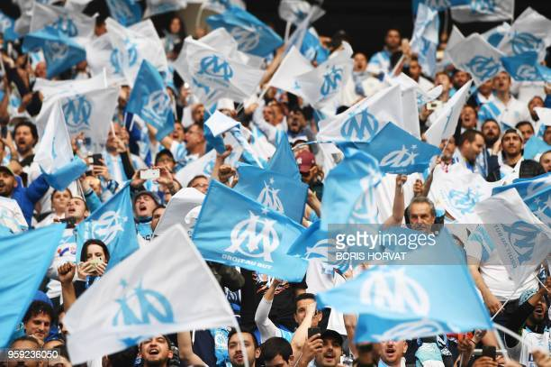 TOPSHOT Marseille's fans wave flags before the UEFA Europa League final football match between Olympique de Marseille and Club Atletico de Madrid at...