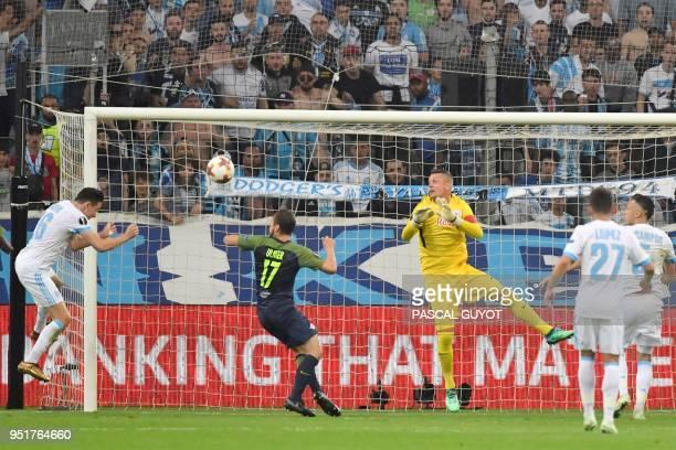Marseille's Florian Thauvin scores a goal during the UEFA Europa League firstleg semifinal football match between Olympique de Marseille and FC...