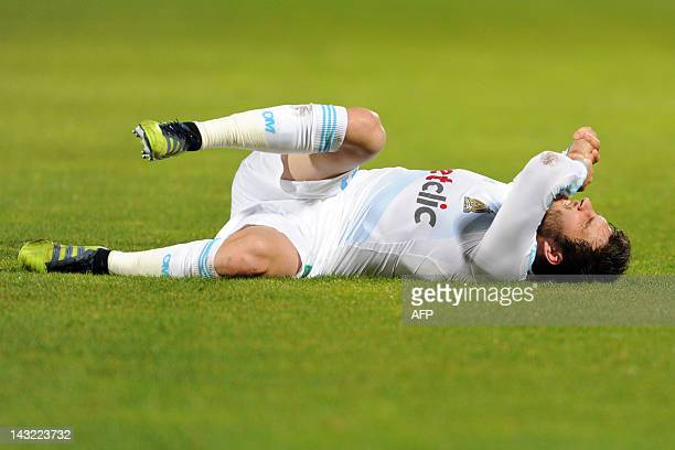 Marseille's forward AndrePierre Gignac lays on the field after being injured during the French L1 football match Bordeaux vs Marseille on April 21...