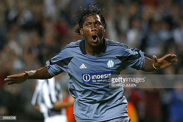 Marseille's forward Didier Drogba jubilates after scoring a goal during during the Champions League soccer match opposing Olympique de Marseille to...