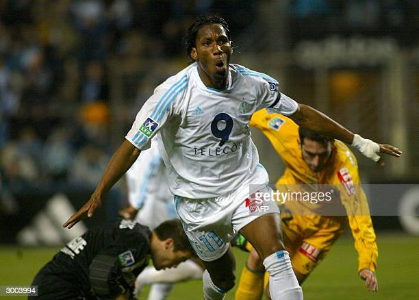 Marseille's forward Didier Drogba jubilates after scoring a goal during the French L1 football match, 22 February 2004 at the Velodrome stadium in...