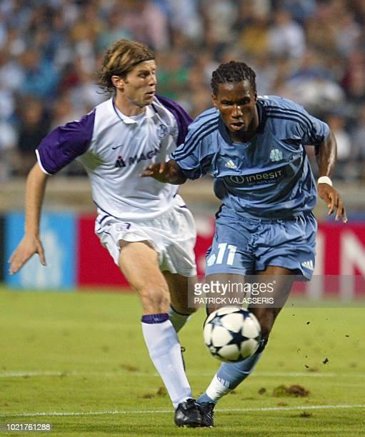 Marseille's forward Didier Drogba vies with Austria Wien's player Franck Verlaat during their Champions League third round qualifier second leg match...