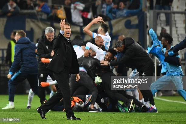 Marseille's French coach Rudi Garcia and players celebrate after winning the Europa League quarter final second leg football match between Olympique...