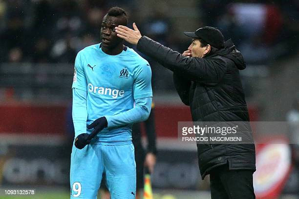 Marseille's French coach Rudi Garcia gestures past Marseille's Italian forward Mario Balotelli during the French L1 football match between Stade de...