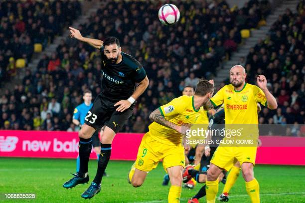 Marseille's French defender Adil Rami heads the ball during the French L1 football match between FC Nantes and Olympique de Marseille at the La...