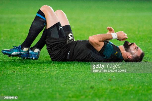Marseille's French defender Adil Rami lies on the pitch during the French L1 football match between FC Nantes and Olympique de Marseille at the La...