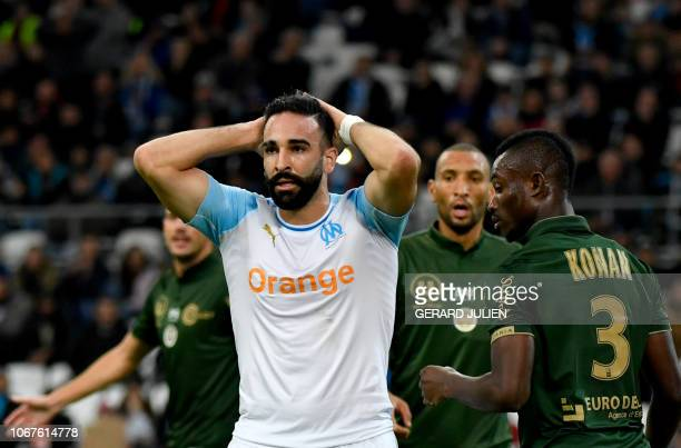Marseille's French defender Adil Rami reacts after failing to score during the French L1 football match between Olympique de Marseille and Reims at...