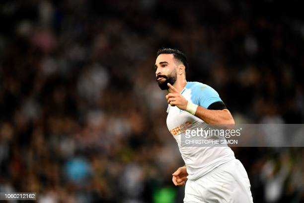 Marseille's French defender Adil Rami reacts after scoring during their French football L1 match Olympique de Marseille vs Dijon on November 11 2018...