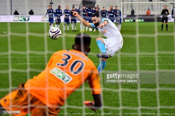 Marseille's French defender Adil Rami shoots and misses in a penalty shoot out leading to Strasbourg winning the French League Cup round of 16...