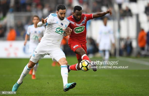 Marseille's French defender Adil Rami vies for the ball with Valenciennes's midfielder Lenny Nangis during the French Cup football match between...