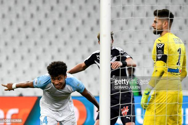Marseille's French defender Boubacar Kamara celebrates after scoring a goal next to Bordeaux's French goalkeeper Benoit Costil during the French L1...