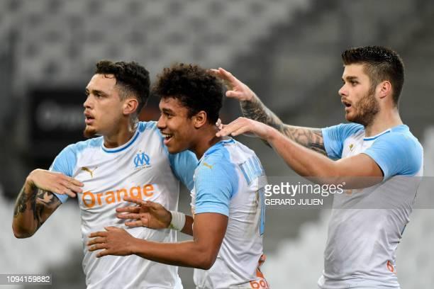 Marseille's French defender Boubacar Kamara celebrates with Marseille's Argentine midfielder Lucas Ocampos and Marseille's Croatian defender Duje...