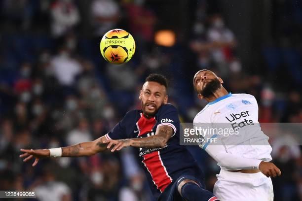 Marseille's French defender Jordan Amavi and Paris Saint-Germain's Brazilian forward Neymar jump for the ball during the French L1 football match...