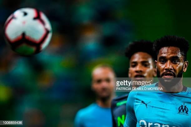 Marseille's French defender Jordan Amavi eyes the ball during a friendly football match between Sporting and Marseille at the Alvalade stadium on...
