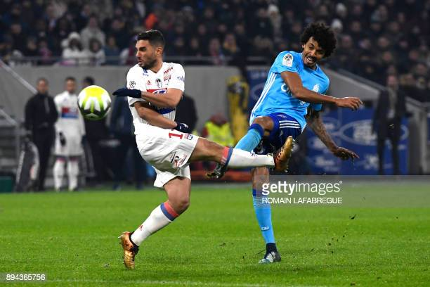 Marseille's French defender Jordan Amavi is challenged by Lyon's French defender Jeremy Morel during the French L1 football match between Lyon and...