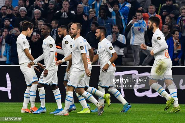 Marseille's French defender Jordan Amavi is congratulated by teammates after scoring a goal during the French L1 football match between Olympique de...
