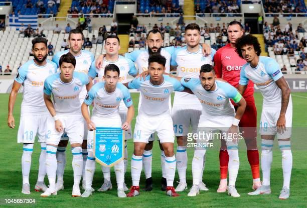 Marseille's French defender Jordan Amavi Marseille's Dutch midfielder Kevin Strootman Marseille's Serbian midfielder Nemanja Radonjic Marseille's...