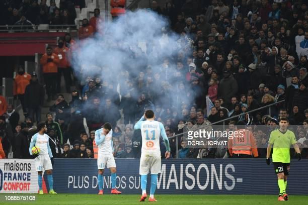Marseille's French defender Jordan Amavi Marseille's Dutch midfielder Kevin Strootman Marseille's Greek forward Konstantinos Mitroglou and Lille's...