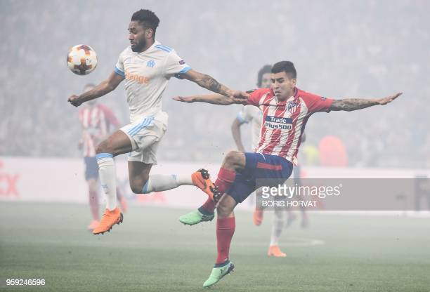 Marseille's French defender Jordan Amavi vies with Atletico Madrid's Argentinian forward Angel Correa during the UEFA Europa League final football...