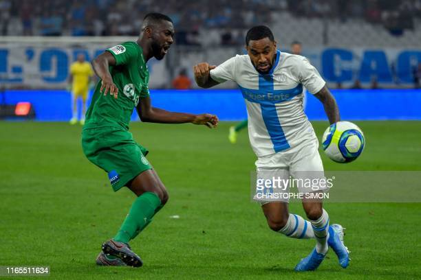 Marseille's French defender Jordan Amavi vies with SaintEtienne's French midfielder JeanEudes Aholou during the French L1 football match between...