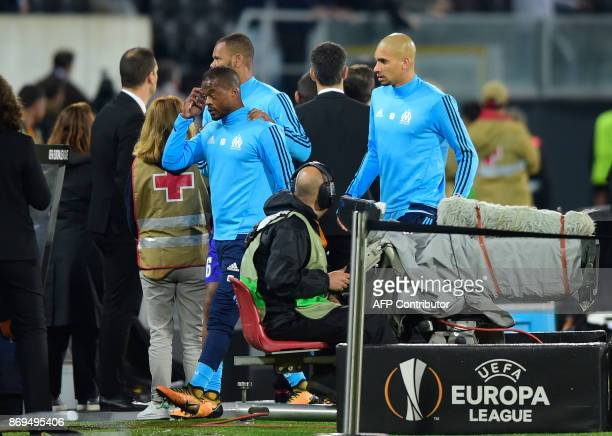 Marseille's French defender Patrice Evra leaves the pitch after an incident with Marseille supporters before the start of the UEFA Europa League...