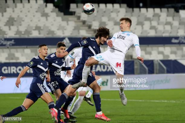 Marseille's French defender Valentin Rongier heads the ball during the French L1 football match between FC Girondins de Bordeaux and Olympique de...