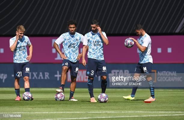 Marseille's French defender Valentin Rongier, Marseille's French defender Boubacar Kamara, Marseille's Spanish defender Alvaro Gonzalez and...