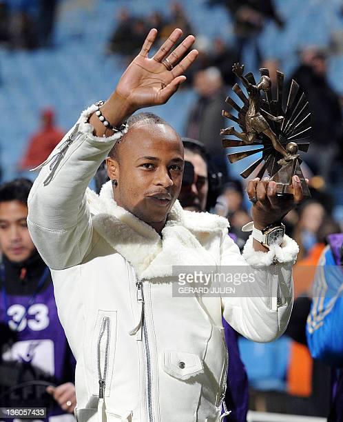 Marseille's French forward Andre Ayew poses with his Best African football player trophy before the French L1 football match Olympique of Marseille...