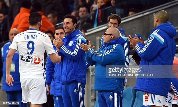 Marseille's French forward AndrePierre Gignac is congratulated after scoring a goal during the French L1 football match between Marseille and Evian...