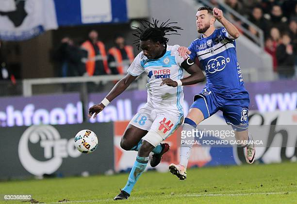 Marseille's French forward Bafetimbi Gomis vies with Bastia's French defender Mathieu Peybernes during the French L1 football match between Bastia...