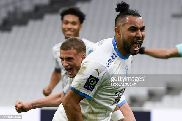 Marseille's French forward Dimitri Payet celebrates after scoring a goal during the French L1 football match between Olympique de Marseille and...