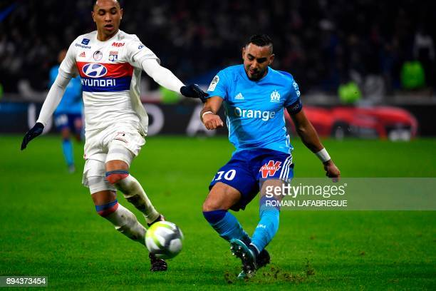 Marseille's French forward Dimitri Payet fights for the ball with Lyon's Dutch defender Kenny Tete during the French L1 football match Olympique...