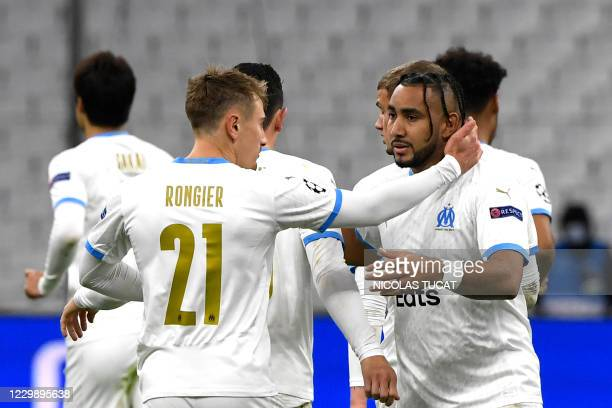 Marseille's French forward Dimitri Payet is congratulated by Marseille's French midfielder Valentin Rongier after scoring a goal during the UEFA...