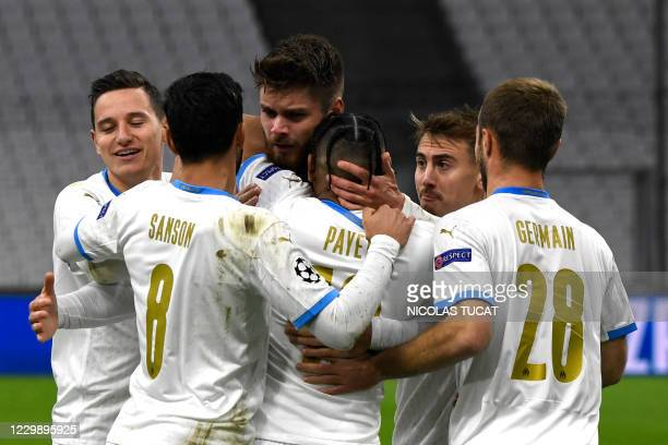 Marseille's French forward Dimitri Payet is congratulated by teammates after scoring a goal during the UEFA Champions League Group C football match...