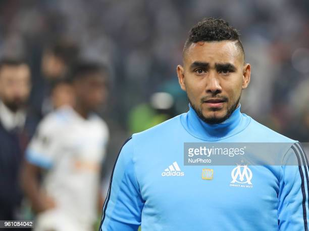 Marseille's French forward Dimitri Payet reacts after being defeated by Atletico at the end of the UEFA Europa League final football match between...