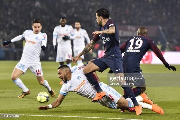 Marseille's French forward Dimitri Payet vies with Paris Saint-Germain's Brazilian defender Dani Alves and Paris Saint-Germain's French midifelder...