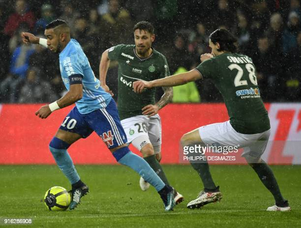 Marseille's French forward Dimitri Payet vies with SaintEtienne's Brazilian midfielder Hernani and Serbian defender Neven Subotic during the French...