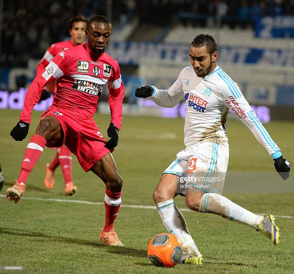 Marseille's French forward Dimitri Payet (R) vies with Toulouse's Guinean defender Issiaga Sylla during the French L1 football match Olympique de Marseille vs Toulouse at the Velodrome stadium in Marseille, on February 2, 2014.
