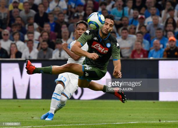 Marseille's French forward Florian Chabrolle kicks the ball next to Napoli's Kostas Manolas during the international friendly football match between...