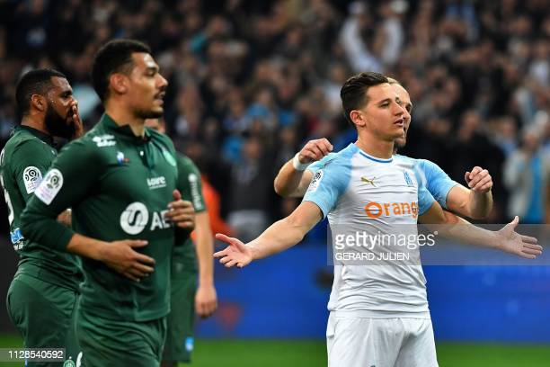 Marseille's French forward Florian Thauvin celebrates after scoring during the French L1 football match between Olympique de Marseille and AS...