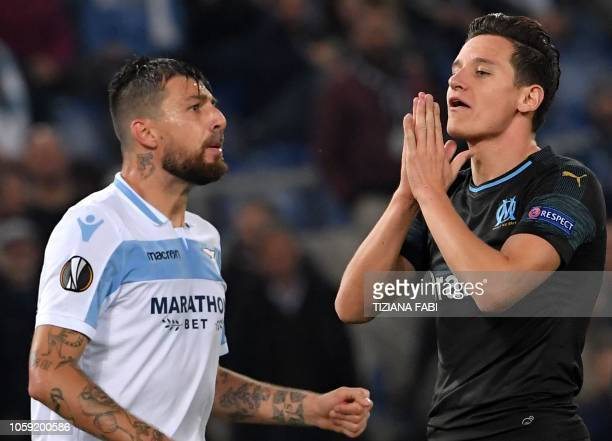 Marseille's French forward Florian Thauvin celebrates next to Lazio's Italian defender Francesco Acerbi after scoring during the UEFA Europa League...