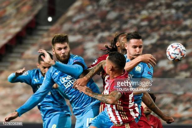 Marseille's French forward Florian Thauvin fights for the ball with Olympiakos' team players during the UEFA Champions League Group C first-leg...